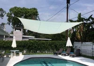 white pool shade hung over pool