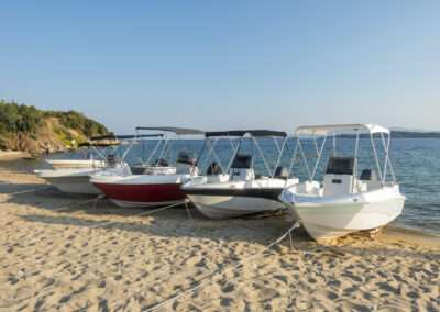 anchored boats on shore
