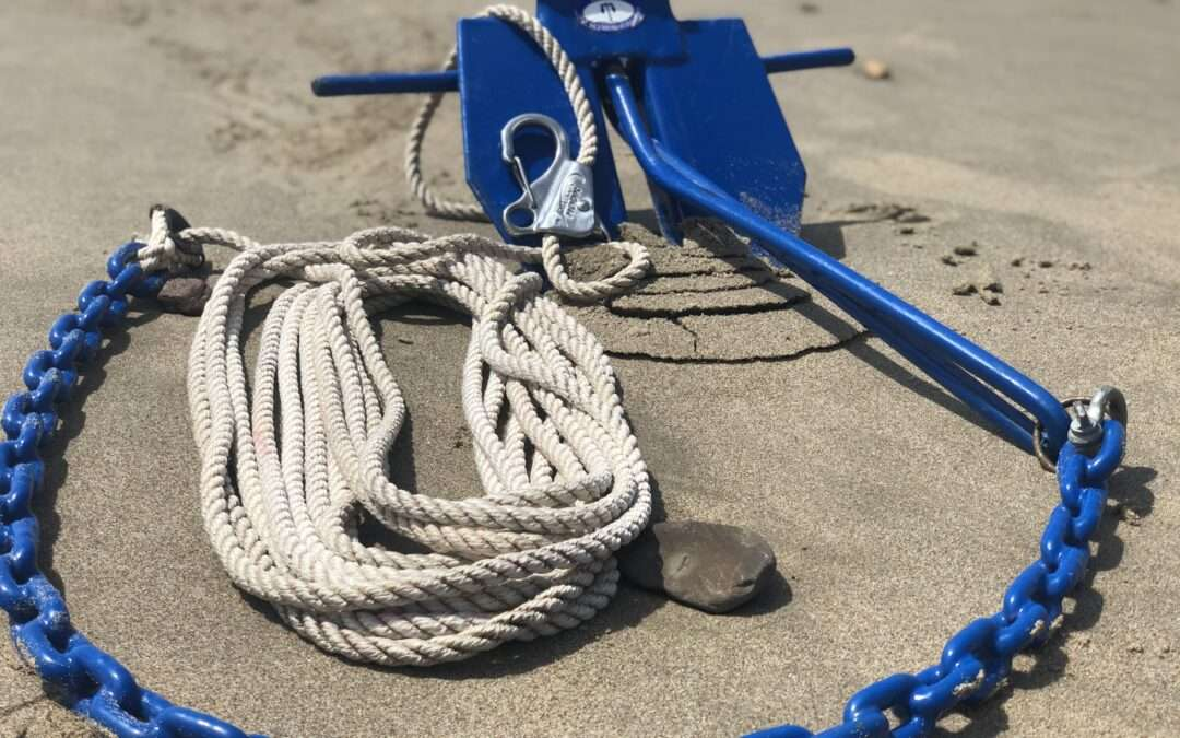 boat anchor hook on sand